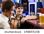 two young men sitting at bar... | Shutterstock . vector #198855158
