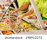 Stock photo tray with cooked food on showcase at cafeteria 198912272