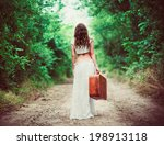 Young Woman With Suitcase In...
