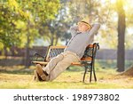 Senior Man Relaxing In Park On...