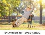 Senior Man Relaxing In Park On...