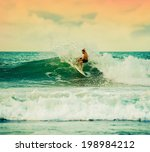 athletic surfer with board on a ... | Shutterstock . vector #198984212