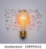 light bulb with drawing graph | Shutterstock . vector #198994412
