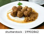 white platter with meat balls on onions sauce - stock photo