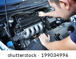 a man checking car engine | Shutterstock . vector #199034996