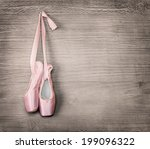 New pink ballet shoes hanging...