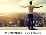 man enjoys view over manhattan | Shutterstock . vector #199176308