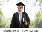 Mature Man In A Graduation Gown ...