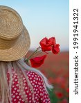 A Girl In A Straw Hat From The...