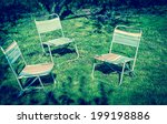 Three Chairs On The Lawn