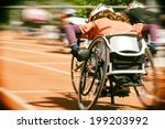 Athletes  at a wheelchair race in a stadium with motion blur and lens vignetting