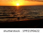 Summer Sunset On The Shore Of...