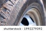 Dirty Car Wheel On A Soil Road...