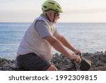 Cyclist Man Riding On A Pebble...