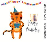 cute funny tiger in party hat ...   Shutterstock .eps vector #1992459635