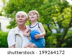 happy grandfather playing with... | Shutterstock . vector #199264172