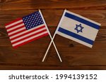 Flag of USA and flag of Israel crossed with each other. USA vs Israel. The image illustrates the relationship between countries. Photography for video news on TV and articles on the Internet and media
