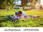father and son lying on the... | Shutterstock . vector #199434296