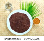 Small photo of South Indian food ragi dosa with chutney.