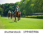 Race Horses With Jockeys On Th...