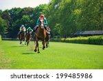 Stock photo race horses with jockeys on the home straight 199485986