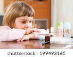 little girl at  table with... | Shutterstock . vector #199493165