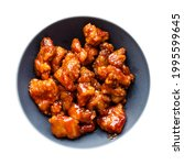 Small photo of chinese cuisine - top view of sweet and sour pork (guo bao rou) cutout on white background