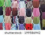 woman scarves at a market stall ... | Shutterstock . vector #199586942