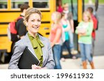 Small photo of School Bus: Cheerful School Principal With Students In Background