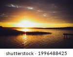 yellow sunset on the lake.... | Shutterstock . vector #1996488425