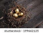 Golden Eggs In Nest On Dark...