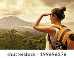 woman traveler looking at batur ... | Shutterstock . vector #199696376