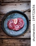 Small photo of Raw slice of ossobuco, cross cut veal shank