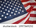 usa flag  close up. studio shot.... | Shutterstock . vector #1997369252