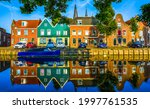 The Houses Are Reflected In The ...