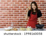 pretty young asian woman chef...
