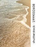 Small Waves On Sandy Beach On...