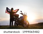Motorcyclist Holding Flag Of...