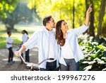 happy indian couple and kids... | Shutterstock . vector #199967276