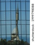 Small photo of Mosque of the Martyrs in Baku in Azerbaijan Reflected in the Modern Glass Facade of an Office Building - Juxtaposition of Old and New