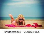 young woman in red bikini...   Shutterstock . vector #200026166