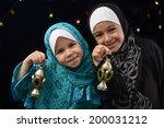 happy muslim girls with ramadan ...   Shutterstock . vector #200031212