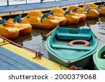 Rowboats And Pedal Boats Are...