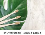 bamboo toothbrush on a table...   Shutterstock . vector #2001513815