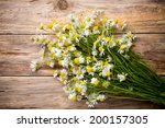 Chamomile Flowers On A Wooden...