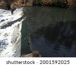 Water Spilling Over A Wier In A ...