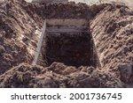 Freshly dug grave pit at...