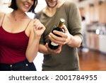couple receiving a bottle of... | Shutterstock . vector #2001784955