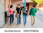 Small photo of Group of high school students talking and laughing in a hallway between classes