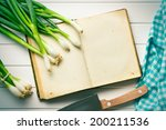 the old recipe book with spring onion - stock photo